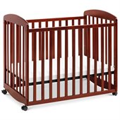 DaVinci Alpha Mini Rocking Wood Baby Crib in Cherry