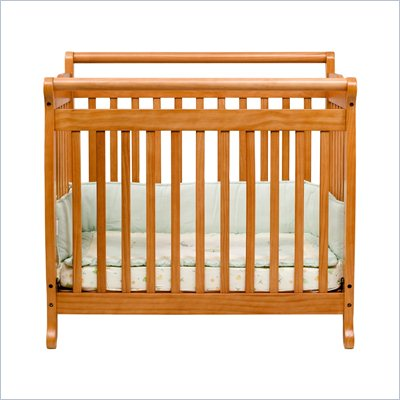 DaVinci Emily Mini 2-in-1 Convertible Wood Baby Crib in Honey Oak