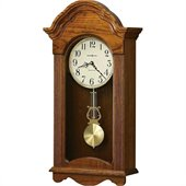 Howard Miller Jayla Wood Wall Clock in a Legacy Oak Finish  