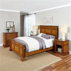 Home Styles Americana King 4 Piece Bedroom Set in Oak