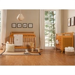 DaVinci Emily 4-in-1 Convertible Crib with Changing Table in Honey Oak
