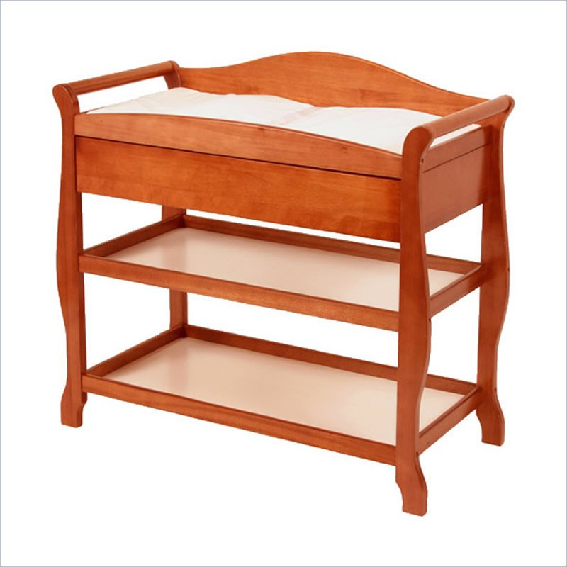 Aspen Sleigh Changing Table with Drawer in Cognac Brown