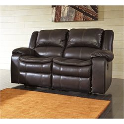 Ashley Long Knight Faux Leather Reclining Loveseat in Brown