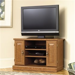 Pemberly Row Corner TV Stand in Carolina Oak finish