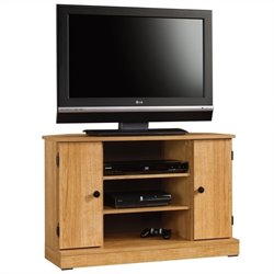 Pemberly Row Corner TV Stand in Highland Oak