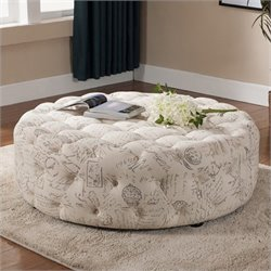 Atlin Designs Round Upholstered Ottoman in Beige Print